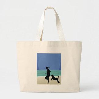 Dog on Beach Canvas Bags