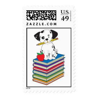 Dog on Books Postage Stamp