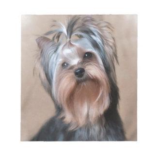 Dog on textile background notepad
