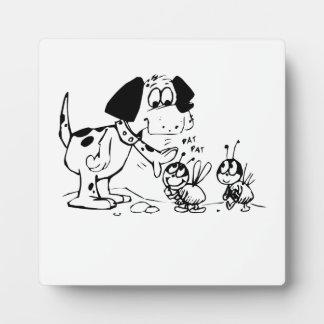 Dog Patting a Bug Photo Plaques