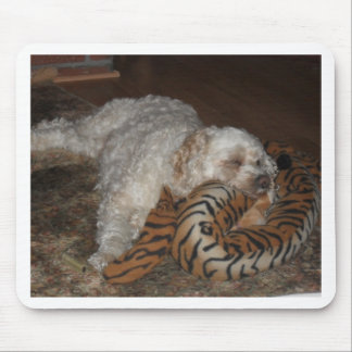 Dog relaxing on tiger striped bed mouse pad