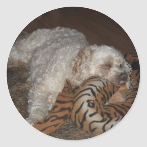 Dog relaxing on tiger striped bed round stickers