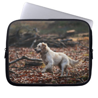 Dog running on dry leaves computer sleeve