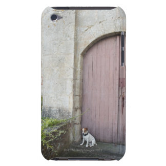 Dog sitting in front of closed doors iPod Case-Mate case