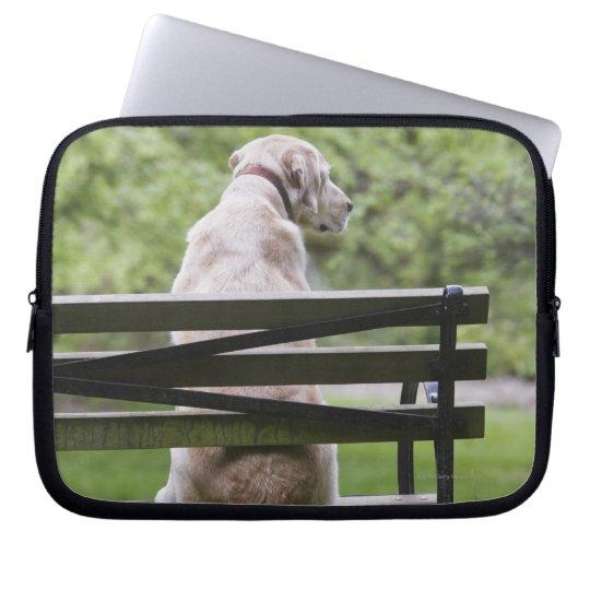 Dog sitting on park bench laptop sleeve