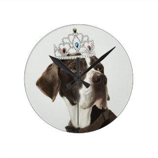 Dog sitting with a tiara on head round clock