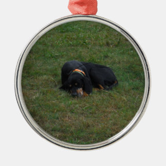 Dog Tired Round Metal Christmas Ornament