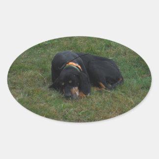 Dog Tired Oval Sticker