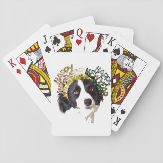 Dog Wearing Happy New Year Hats Playing Cards