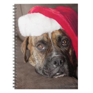 Dog wearing Santa hat Spiral Notebooks