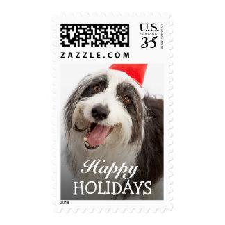 Dog wearing Santa hat Stamps