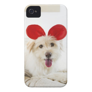 Dog wearing toy ears on bed iPhone 4 Case-Mate case