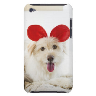 Dog wearing toy ears on bed iPod touch cover