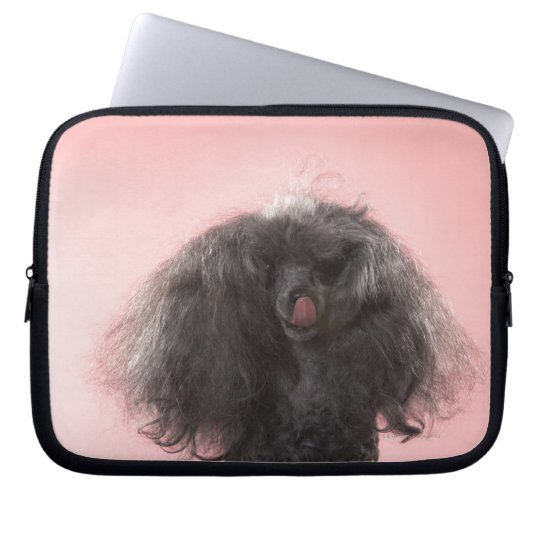 Dog with hair in front of face and tongue out computer sleeve