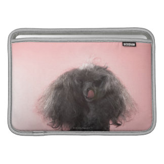 Dog with hair in front of face and tongue out MacBook air sleeve