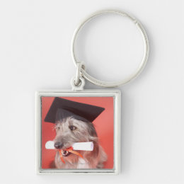Dog with mortarboard and diploma keychain