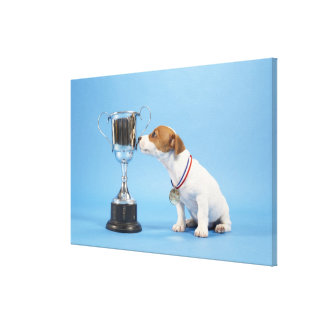 Dog with trophy canvas print