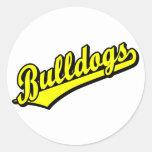 Dogos en amarillo pegatinas redondas