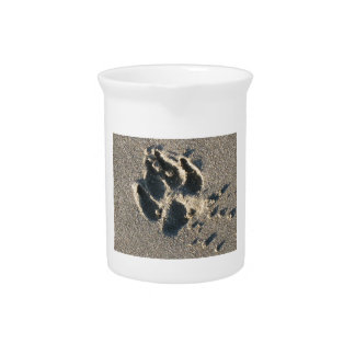 Dog's paw-print in the sand drink pitcher