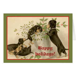 Dogs playing with Christmas mistletoe & holy berry Greeting Cards