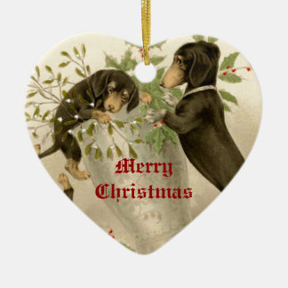 Dogs playing with Christmas mistletoe & holy berry Double-Sided Heart Ceramic Christmas Ornament