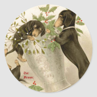 Dogs playing with Christmas mistletoe & holy berry Round Sticker