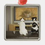 Dogs watching dog dish with food on TV Metal Ornament
