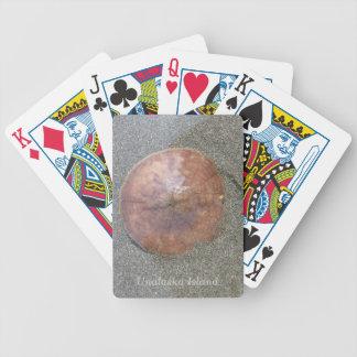 Dólar de arena en la playa baraja cartas de poker