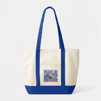 Dolphin and diving birds tote bag