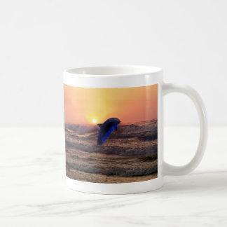 Dolphin at sunset coffee mug