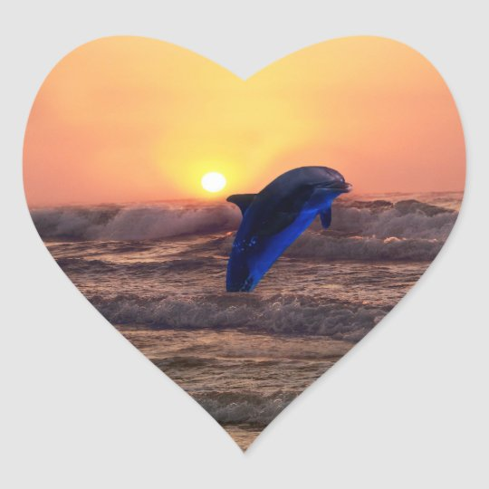 Dolphin at sunset heart sticker
