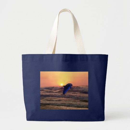 Dolphin at sunset large tote bag