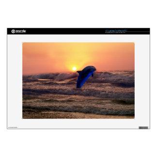 Dolphin at sunset laptop skin