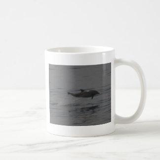 Dolphin breaching at Cambria, California Coffee Mug