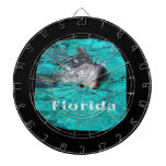 dolphin coming out of teal clear water florida dartboards