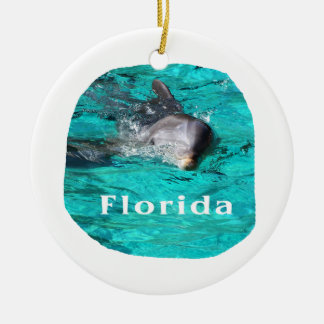 dolphin coming out of teal clear water florida christmas tree ornament