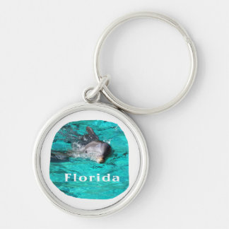 dolphin coming out of teal clear water florida Silver-Colored round keychain