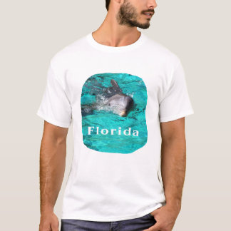 dolphin coming out of teal clear water florida T-Shirt
