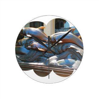 Dolphin Dance statue outside Boston Aquarium Round Clock
