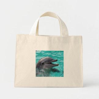 Dolphin head in aquamarine water mini tote bag