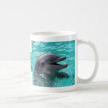 Dolphin head in aquamarine water mugs