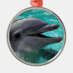 Dolphin head in aquamarine water round metal christmas ornament
