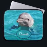 """Dolphin in Blue Water Photo Computer Sleeve<br><div class=""""desc"""">Grey dolphin photograph smiling out of beautiful clear ocean water. You can personalize it by adding any text you want,  your names,  or your initials. Just change the text added to your own choice.</div>"""