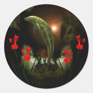 Dolphin in stone round sticker