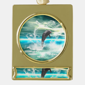 Dolphin jumping in the sea with waves as heart gold plated banner ornament