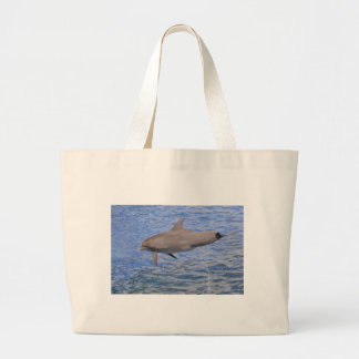 Dolphin jumping out of the water large tote bag