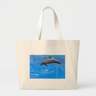 Dolphin jumping out of water large tote bag