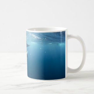 Dolphin pod swimming underwater coffee mug