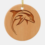 Dolphin silhouette engraved on wood design ceramic ornament