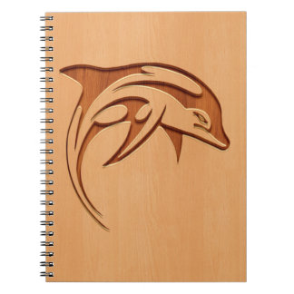 Dolphin silhouette engraved on wood design notebook